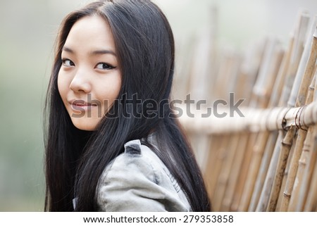 Young woman in the rays of the autumn sun. - stock photo