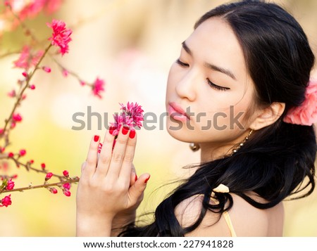 Young woman in the rays of the spring sun. - stock photo