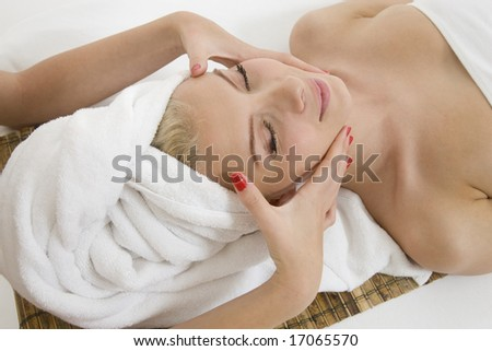 young woman in the sauna on isolated studio pictures