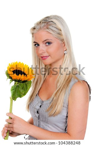 young woman in the summer with a sunflower.