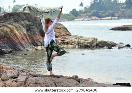 Young woman in the traditional Indian punjabi dress on the beach. South Goa, India - stock photo