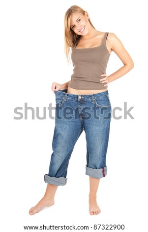 young woman in too great trousers, white background