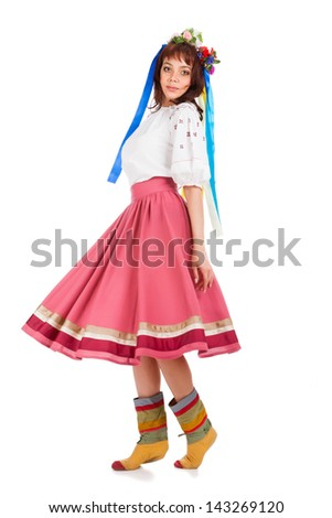 Young woman in traditional Ukrainian costume - stock photo
