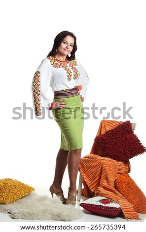 young woman in Ukrainian costume. national traditions, beautiful hair, bright emotions - stock photo