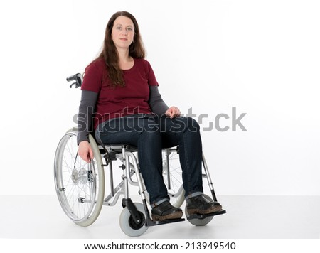 young woman in wheelchair  - stock photo