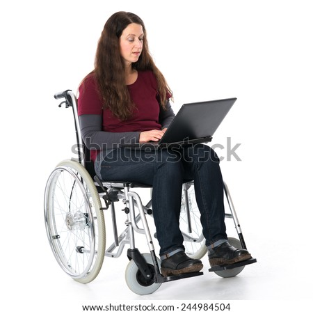 young woman in wheelchair working with the computer  - stock photo
