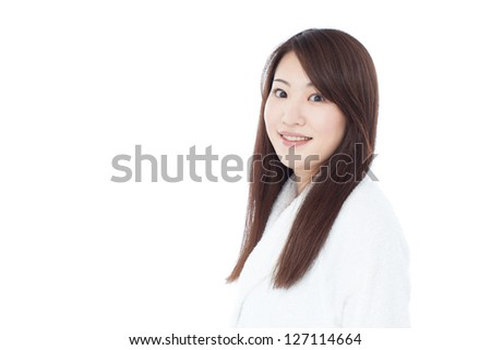 young woman in white bath robe, isolated on white background - stock photo