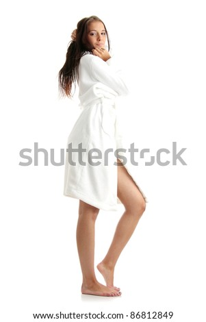 Young woman in white bathtub isolated on white background