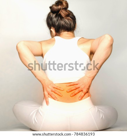 young woman in white clothes , grabbing an Waist, She has back pain. Waist pain And Care Concept.