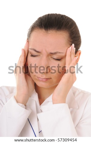 Young woman in white coat with headache isolated on white background - stock photo