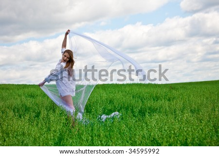 Young woman in white on a meadow