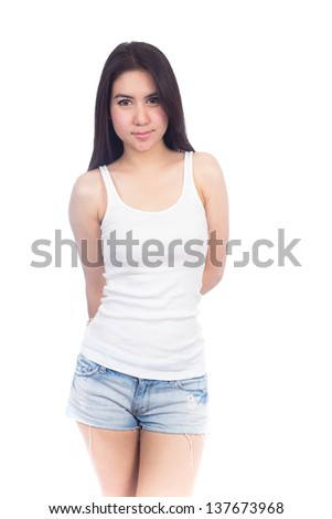 Young woman in white T-shirt and short jeans on white background - stock photo