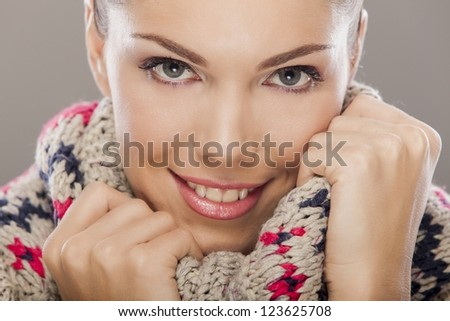 Young woman in winter clothes - stock photo