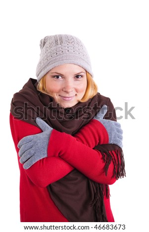 Young woman in winter clothes trying to warm up.