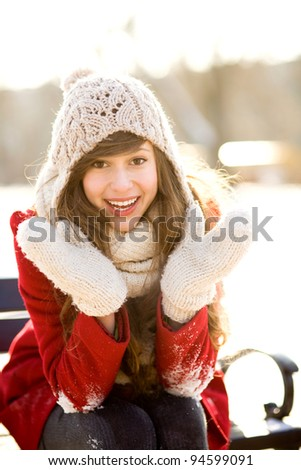 Young woman in winter clothing - stock photo