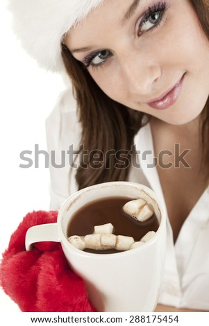 Young woman in winter hat with cup of hot chocolate - stock photo