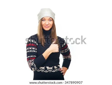 Young woman in winter jacket holding thumbs up. Beautiful girl on a white background. Thumbs up - woman. New year - concept.