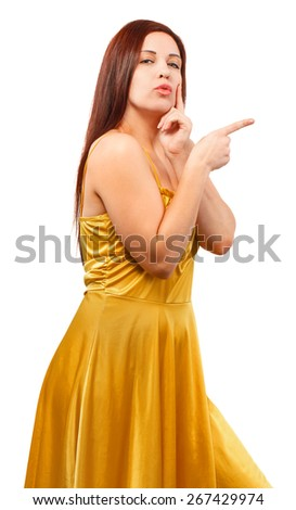 Young woman in yellow dress point finger showing something to side empty copy space isolated on white background - stock photo