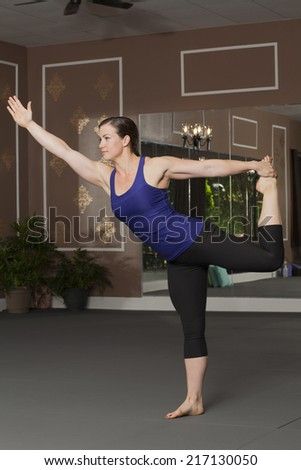 Young Woman in Yoga Pose - stock photo