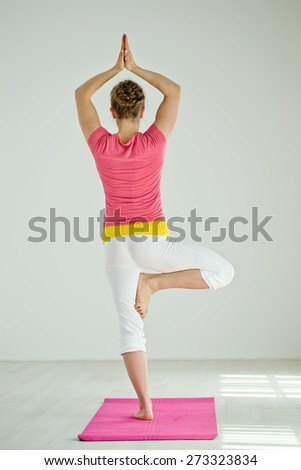 Young woman in yoga pose. Series. - stock photo