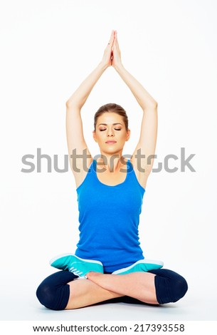 young woman in yoga pose sitting on a floor . white background isolated . - stock photo