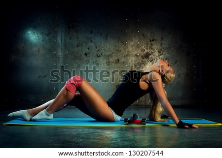 Young woman indoors fitness exercises. - stock photo