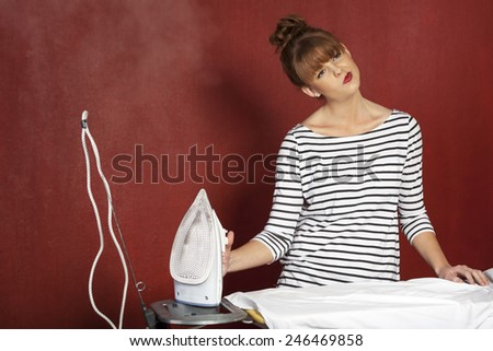 young woman ironing  - stock photo