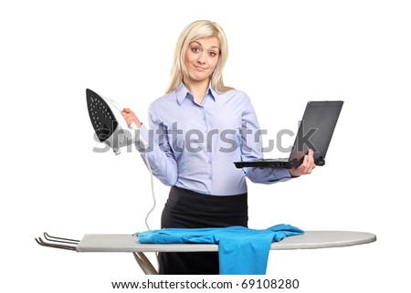 Young woman ironing his clothes and working on a laptop isolated against white background - stock photo