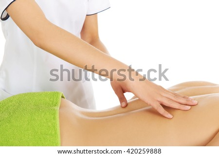 Young woman is being massaged.  - stock photo