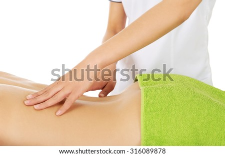 Young woman is being massaged, isolated on white. - stock photo