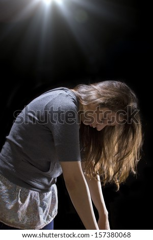 young woman is being taken by a UFO by levitation - stock photo