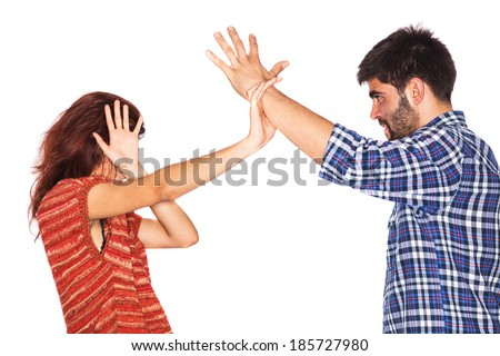 Young woman is covering her face while her violent husband wants to hit her with his hand - isolated on white - stock photo
