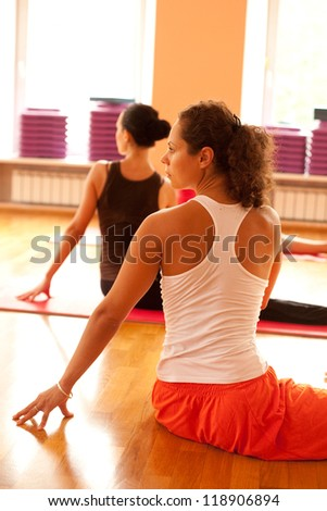 Young woman is doing yoga at yoga club - stock photo