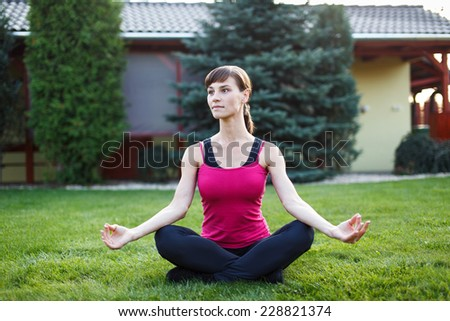 Young woman is doing yoga, outdoor exercise