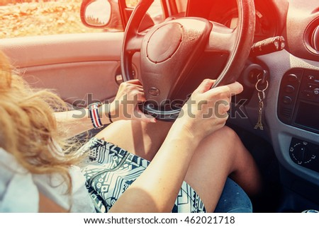 Young Woman is Driving a Car. Vintage filter