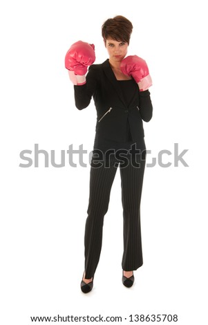Young woman is enjoying a boxing fight in business isolated over white background - stock photo