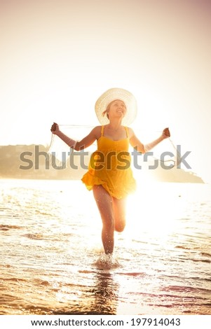 Young woman is enjoying beach early in the morning.