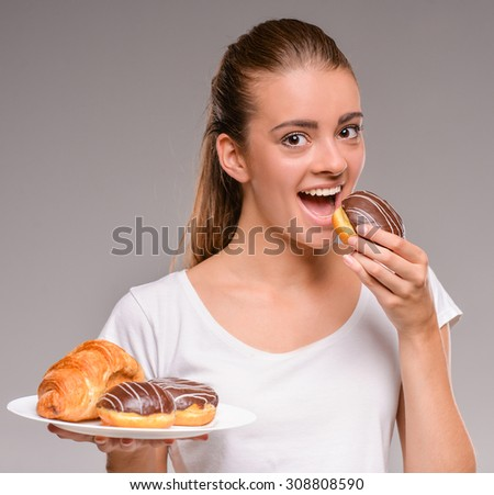 Young woman is going to eat sweets. Healthy food concept. - stock photo