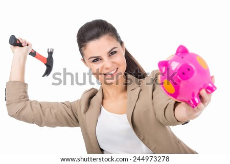 Young woman is going to smash piggy bank with a hammer, isolated on white background. - stock photo