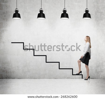 Young woman is going up to the career ladder - stock photo