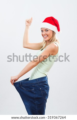 Young woman is happy because sees the result of her exercise and healthy eating.Fit for holidays - stock photo