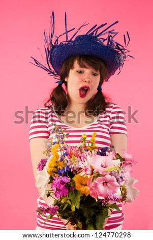 Young woman is happy with bouquet flowers