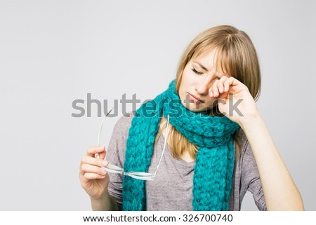 Young woman is having eye ache, she is in depression. She is rubbing her eyes.  - stock photo