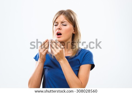 Young woman is having flu and she is sneezing.Woman having flu - stock photo