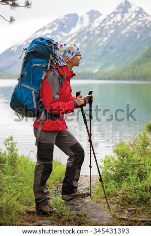 Young woman is hiking in forests of Siberia, Russia