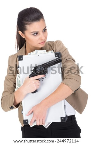 Young woman is holding a suitcase full of money and gun, isolated on white background. - stock photo