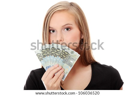 Young woman is holding euro bills and covering mouth. Isolated on the white background.