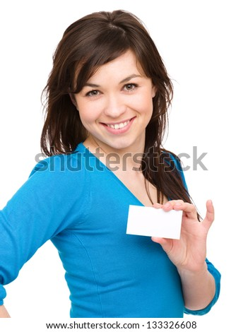 Young woman is holding visit card, isolated over white