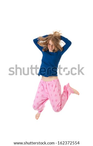Young woman is jumping in blue and pink pajamas