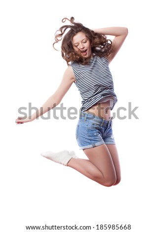 Young woman is jumping. Isolated on white background. Studio shot